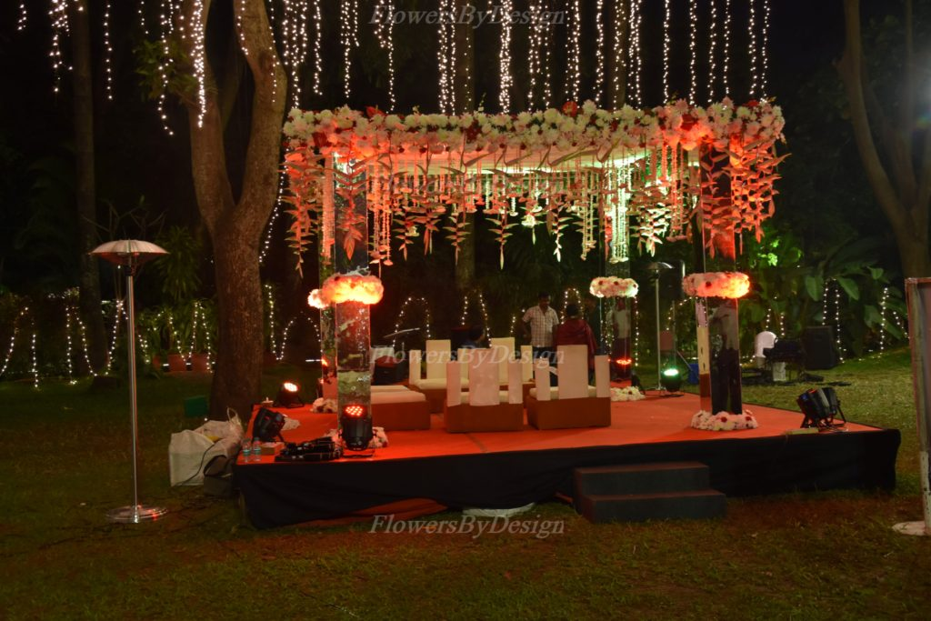 Open Lawn Stage Decoration - Flowers By Design in Bangalore